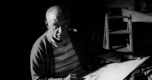Michel Sima, Pablo Picasso drawing in Antibes,1946. Black-and-white photograph. Photo © Michel Sima / Bridgeman Images